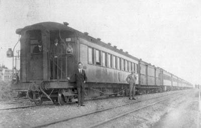 Robert Strong standing in front of train carriage